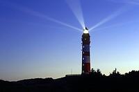 Lighthouse with light beam in the night, Amrum, Northfrisian Islands, Schleswig-Holstein, Germany, Europe.