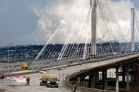 Canada, BC, Vancouver. The newly completed 10 lane, cable-stayed Port Mann Bridge behind the old structure of the same name. It crosses the Fraser Riv...
