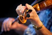 Closeup of man playing violin.
