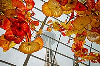 The Seattle Space Needle through decorative glass roof of the museum, Chihuly Garden and Glass museum, Seattle, USA.