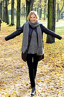 Middle aged Woman walking on a beautyful Parkway