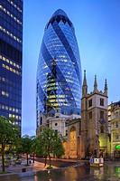 Gherkin 30 St Marys Axe with St Andrew Undershaft Church London England.