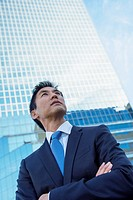 Business executive in front of skyscraper building.