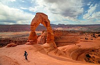 Delicate Arch stands prominent during threatening skies at Arches National Park, Utah.
