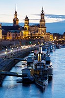 river Elbe with ships, Dresden Castle, appellate court and Dresden Cathedral at night, Dresden, Saxony, Germany.