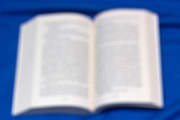 Book unfocused on blue background.