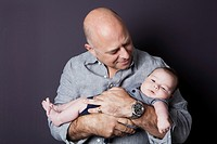 Father holding his baby son.