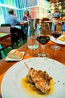 Chicken brochette with vegetables in a restaurant. Madrid, Spain.