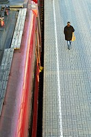 Person walking on the platform of Belarus station, Moscow, Russia, Europe.