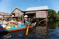 Cambodian woman on the boat in the floating village in Tonle Sap lake in Cambodia.