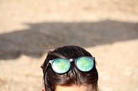 detail of woman wearing sunglasses