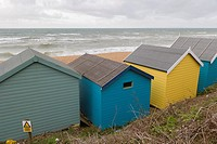 Sea coast with beach huts, Milford on Sea, Hampshire, South England, UK.