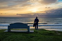 A person viewing the sunset over the ocean from Law Street Park. San Diego, California, United States.