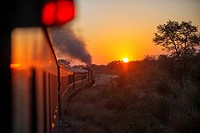 Sunset in the Royal Livingstone Express luxury train. The Steam Locomotive, 156 is a 10th Class originally belonging to the Zambezi Sawmills Limited. ...