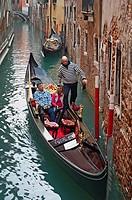 Gondola in a canal, Sestiere San Marco, Venice, Veneto, Italy.
