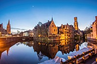 Belfry from the Rozenhoed canal of Bruges reffered as to ´´ The Venice of the North ´´ pictured at night .