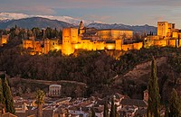 The magnificent Alhambra palace, illuminated at dusk. On the right the Alcazaba (Moorish castle). In the foreground the Albaicín, Granada´s characteri...