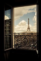 The Eiffel Tower, Paris, France, viewed through an open window.