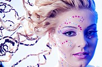blond girl with fancy hairstyle and makeup.