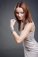 Studio portrait of a female office worker with strong biceps.
