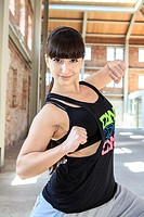 woman in sport dress dancing zumba or aerobics.