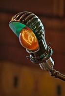 Thomas Edison carbon filament light bulb replica in a bankers desk style lamp.