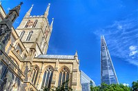 HDR image of Southwark Cathedral or The Cathedral and Collegiate Church of St Saviour and St Mary Overie, Southwark with the Shard in the distance.