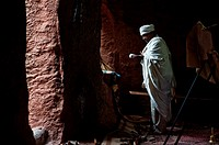 Priest reading the Bible during a mass in a orthodox church i.e. Bet Giyorgis church. Lalibela, Ethiopia.