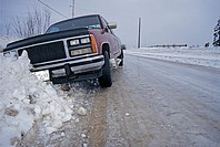 Pickup truck in ditch after sliding off icy road, Smithers, British Columbia.