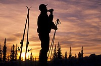 Backcountry skier silhouette at sunset, Hudson Bay Mountain, Smithers, British Columbia.