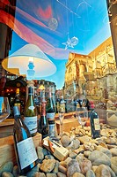 Wine shop with Saint Martin´s church reflection at the city center. Colmar, Haut-Rhin, Alsace, France.