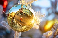 Typical half-timbering houses reflected on a Christmas bauble. Colmar. Haut-Rhin. Alsace. France.