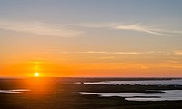 Landscape on the island of South Uist (Uibhist a Deas) in the Outer Hebrides. Sunset at Rueval. Europe, Scotland, June.
