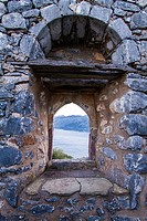 A window in the wall of Sotiros Monastery looking to Laconian Bay.