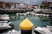 View of the port of Llanes with a yellow pile in the foreground. LLanes. Asturias. Spain.