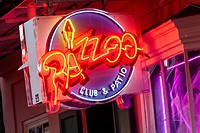 The Neon sign advertising the Pazzoo Night Club, on Bourbon Street, New Orleans.
