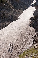 Mountaineers crossing a glacier on Olympus mountain. Macedonia, Greece.