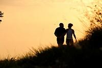 A couple walking in the suset, Collserola mountain, Barcelona, Catalonia, Spain