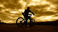 Cyclist at dawn. Peniscola, Valencian Community, Spain.