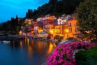 Italy, Lombardy, Lake Como, Varenna, View of illuminated waterfront at lake