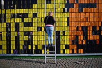 Happy Wall, created by Thomas Dambo, is an analog interactive pixel sculpture made out of the remnants of Tuborg's cinema tribune at.