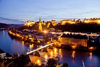 Cityscape Burghausen on the Salzach river with castle and parish church St. Jakob in Burghausen at night, Bavaria, Germany, Europe.