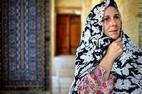 Caucasian female tourist passing by and looking around at Nazir-al Molk Mosque (Masjed-e Nazir-al-Molk), Shiraz, Iran, Central Asia.