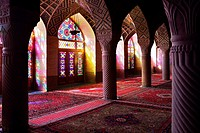 Inside the winter prayer hall of Nazir-al Molk Mosque (Masjed-e Nazir-al-Molk) with the morning sun sending colorful rays through the stained glass, S...