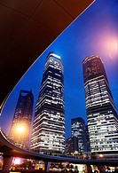 Circular pedestrian overpass and skyscrapers in Lujiazui, Pudong, Shanghai, China. Nighttime scenery. 2014.
