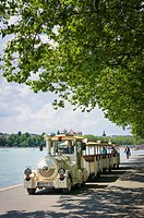 Tourist train by Lake Annecy, Annecy town, Haute-Savoie, France.