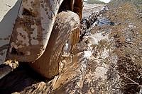 Jeep stuck in deep mud closeup, Mojave Desert, California, USA.