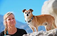 Woman and chihuahua mix, Mojave Desert, California, USA