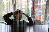 Young boy playing with his friend. Special effect, behind the curtains. Barcelona, Catalonia, Spain.