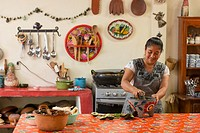Oaxacan chef Reyna Mendoza Ru'z of El Sabor Zapoteco Cooking School hand makes traditional food in her kitchen in Teotitlan, Mexico.